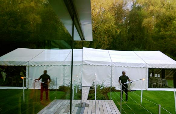 Marquee attached to a glass house in Farnham