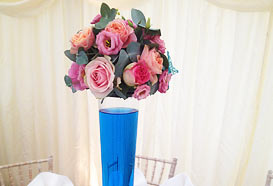 Tall elegant table centrepiece with roses