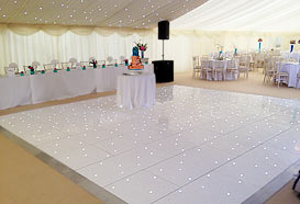 Top table and white starlit dance flooor