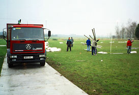 Poles are unloaded from the lorry