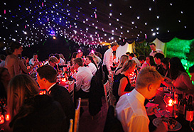 Dining in a 18th birthday party marquee