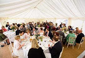 Wedding marquee with guests seated at tables