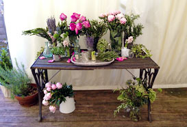 Table of vintage items and traditional flowers
