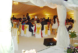 Dining inside a large wedding marquee
