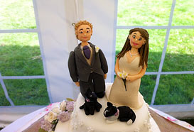 Bride and groom on the wedding cake
