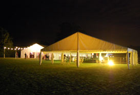 Two marquees lit at night