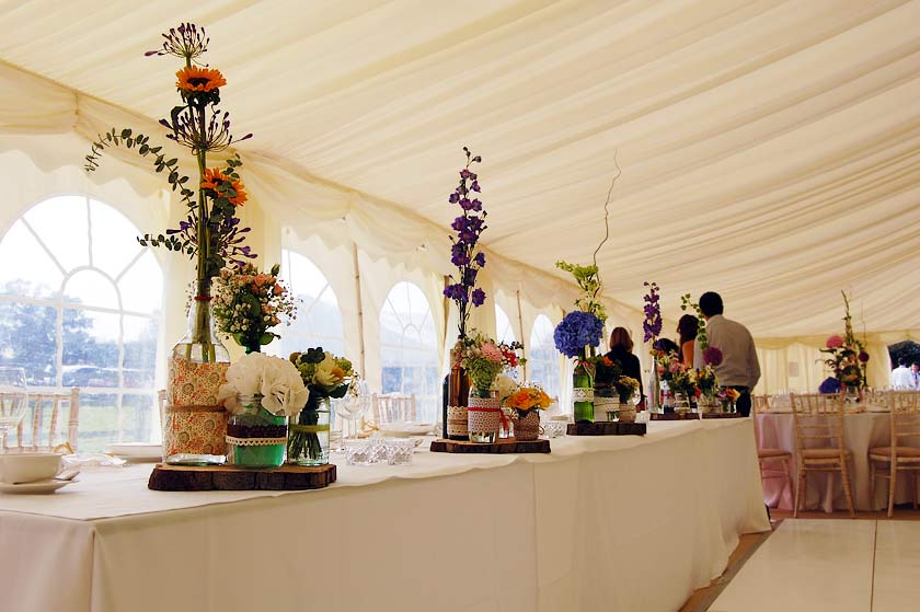 Luxury marquee hire case study of a classy wedding marquee colourful table centrepieces on the top table here were a perfect foil to the otherwise light marquee dressing junglespirit Images