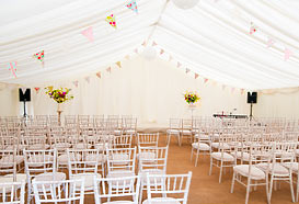 Marquee laid out for a wedding ceremony