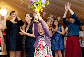 The excited child that caught the bouquet
