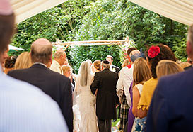 Wedding blessing in a marquee