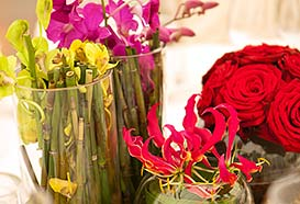 Contemporary flower arrangement of bamboo and orchids