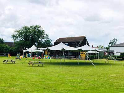Rain cover tents for a sports club