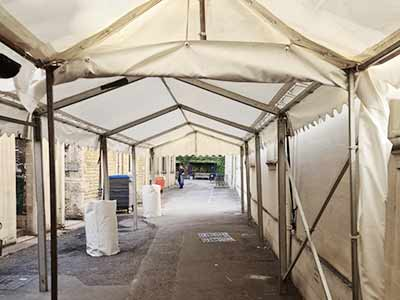 Tent walkway as wether protection for canteen queue