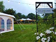 Wedding reception in a traditional marquee