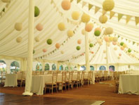 Traditional marquee interior with bunting and paper lanterns