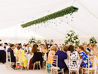 Marquee walls decorated with flowers