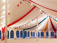 Marquee roof decorated with fabric overlays