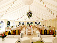 Marquee with sofas, tables and cube seating