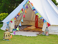 Bell tent decorated with bunting