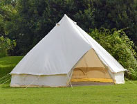 Bell tent in a field setting