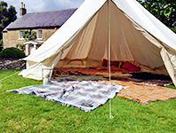 Bell tent decorated with rugs