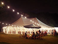 Traditional marquee lit up at night