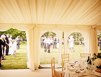 Welcoming guests into the wedding marquee