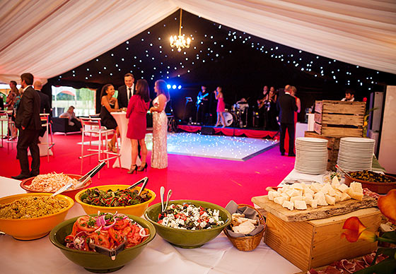 Party marquee with candles and night sky