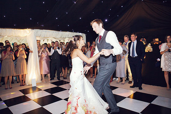 Bride and groom first dance in wedding marquee in MIlton Keynes, Buckinghamshire