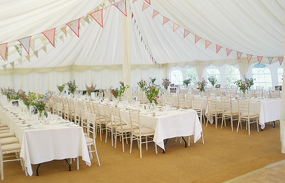 Marquee with bunting strung accross the roof