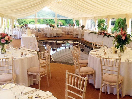 Open sided marquee round a pond