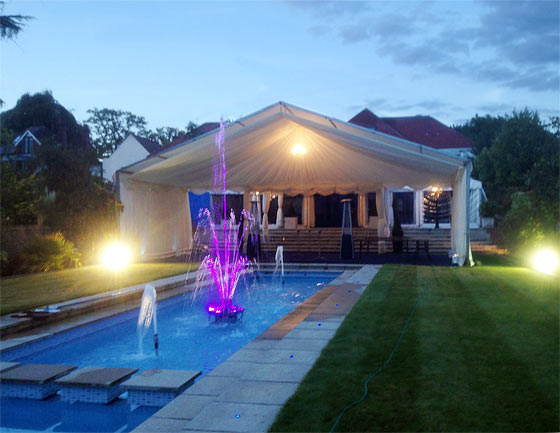 Two marquee set up in Winchmore Hill that takes advantage of beautiful garden features