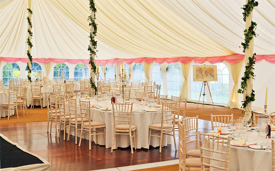 Bright wedding marquee with white and pink colour scheme