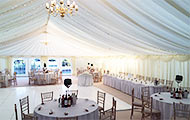 Traditional wedding marquee with lilies
