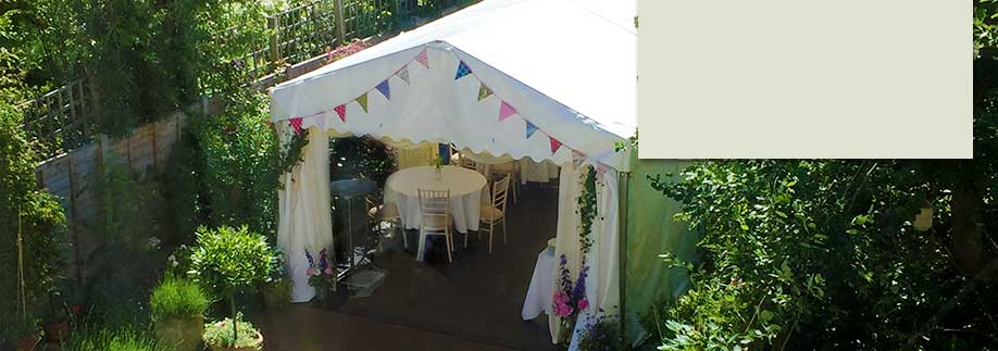 Party tent in long thin London garden