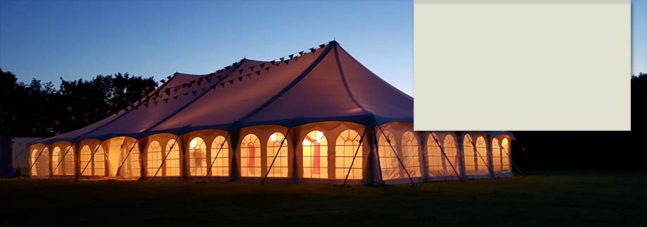 Traditional style tent lit up at night