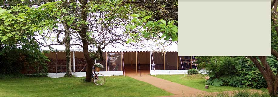 Traditional style tent at wedding venue Westmead Events at dusk