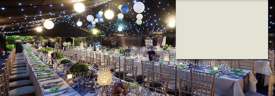Hanging lanterns and a night sky in glittering fiftieth party marquee