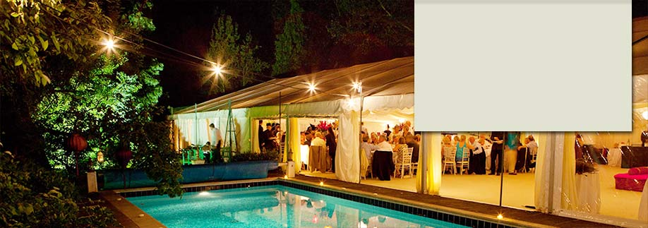 Wedding reception marquee by swimming pool