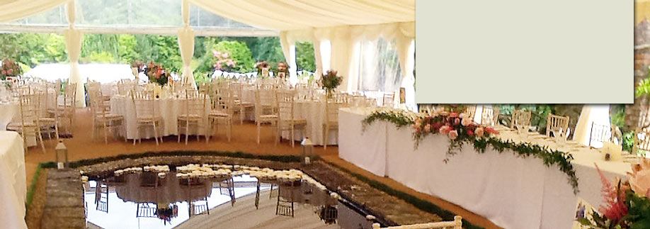 Marquee with greenery from the garden showing though open sides