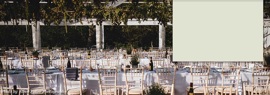 Trestle tables and gilt chairs